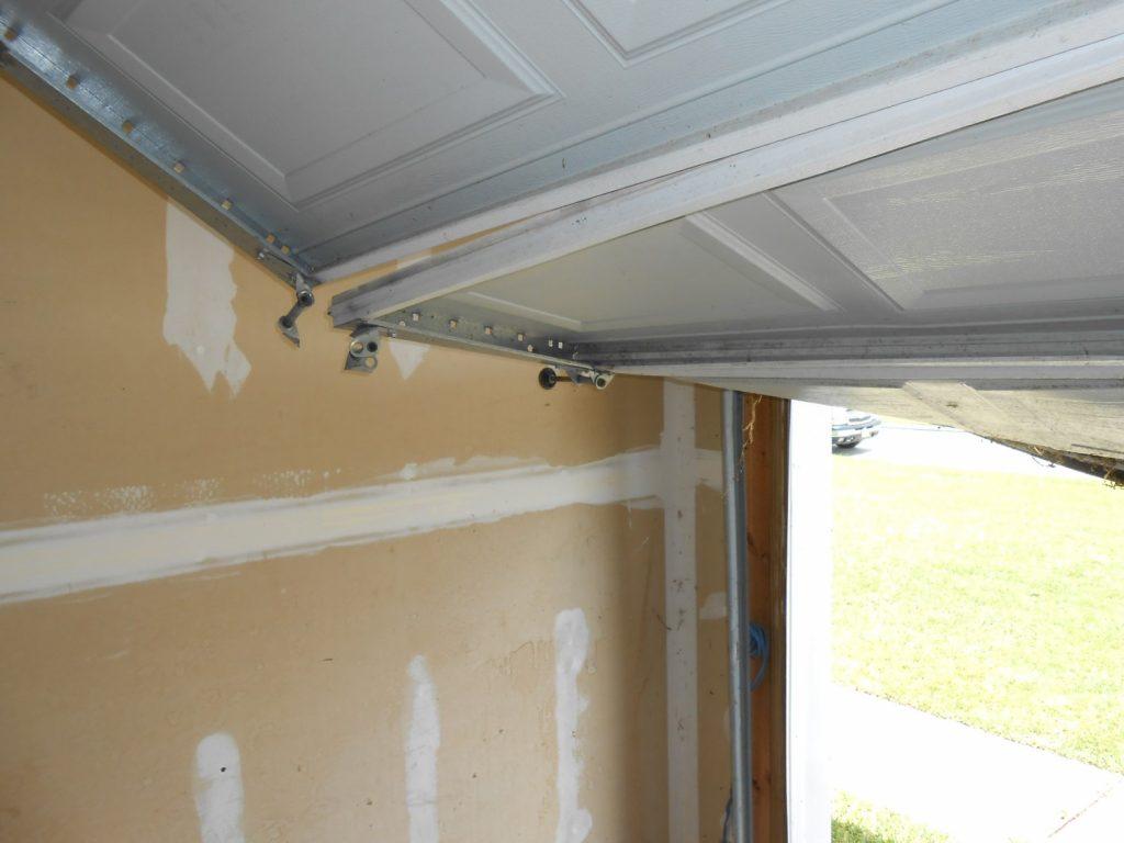 garage door damaged on a home inspection