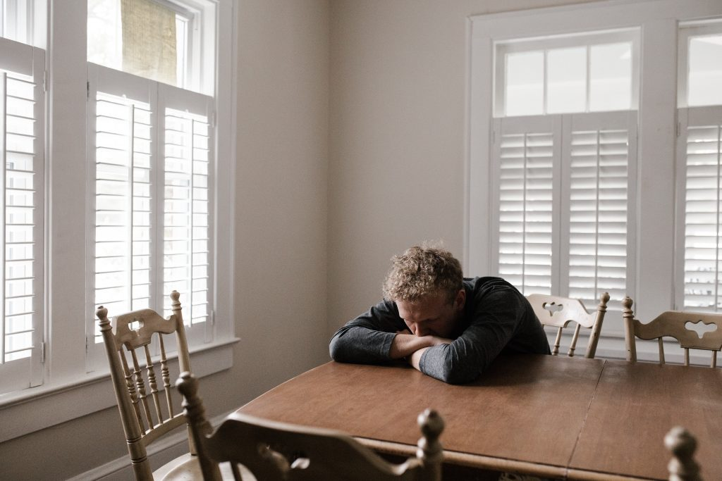 home inspector anxiously waiting for a phone call from a seller