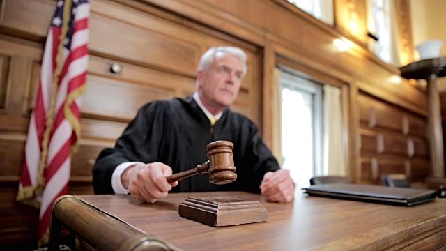 judge presiding over a court case involving a home inspector