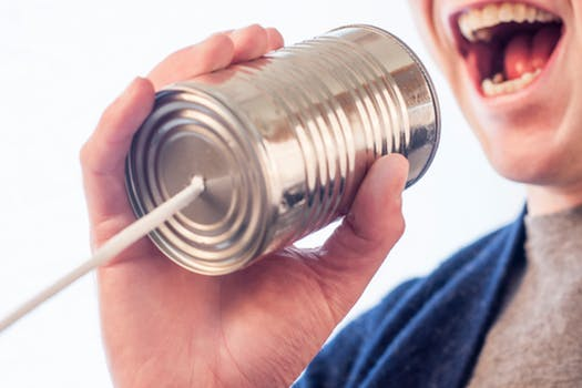 pic of talking into a tin can