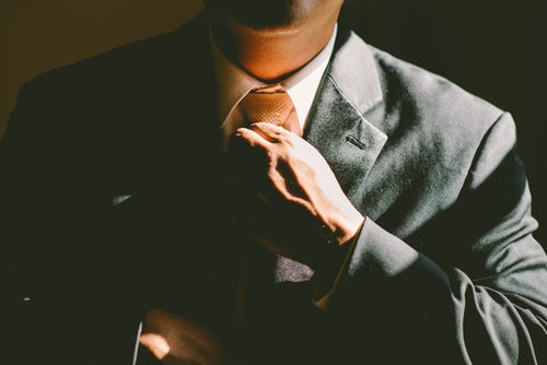 pic of man straightening his tie