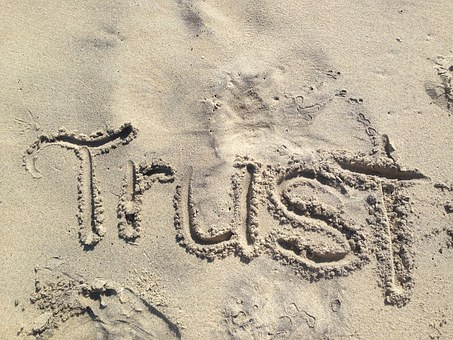 pic of trust written in sand
